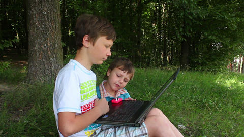 Boys in forest this notebook 4 Stock Video Footage
