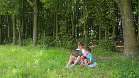 Boys in forest this notebook 8 Stock Video Footage