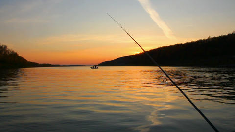 fishing on river at sunset Stock Video Footage