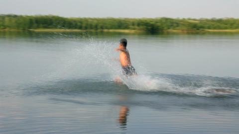 boy jumping in lake - slow motion Stock Video Footage