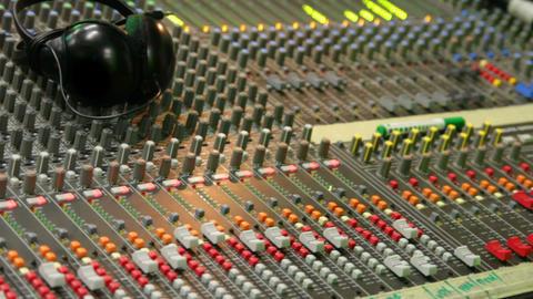 controls of dj music mixer close-up Stock Video Footage