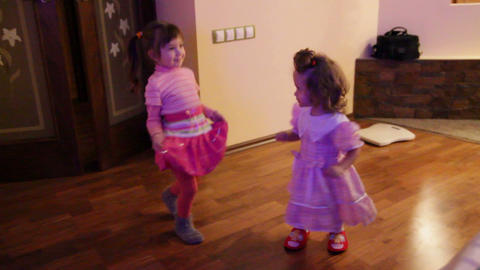 two little girls dancing at home Stock Video Footage