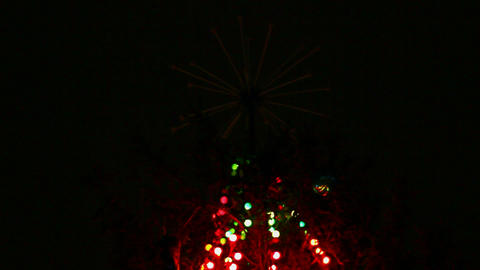 top of christmas fir with colored lightings Stock Video Footage