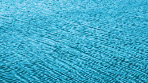 turquoise water background with sun reflections Stock Video Footage
