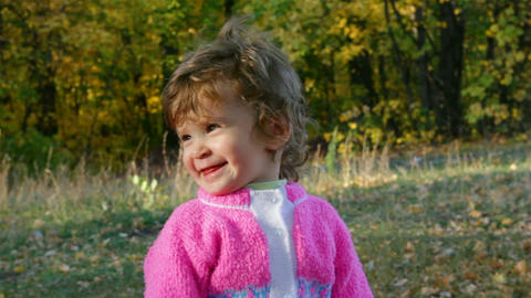 baby girl in autumn park Stock Video Footage