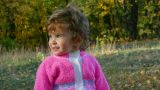 baby girl in autumn park Footage