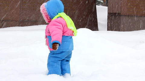 baby girl walking in winter park Stock Video Footage