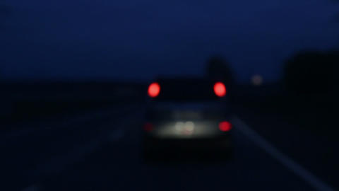 driving on night roads with headlights defocused Stock Video Footage