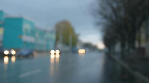defocused cars moving on street at rain - timelaps Stock Video Footage