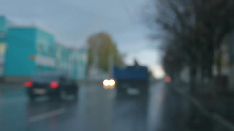 defocused cars moving on street at rain - timelaps Stock Video Footage