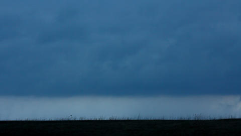 Cars silhouettes on road against moody sky Stock Video Footage