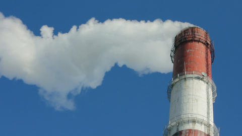 factory chimney with smoke under blue sky Stock Video Footage