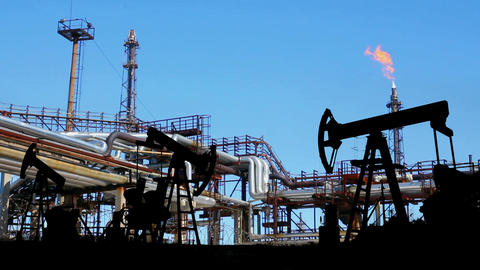 petrochemical factory and oil pumps silhouette Stock Video Footage