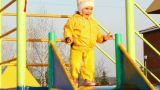 cute little girl in yellow on slide Footage