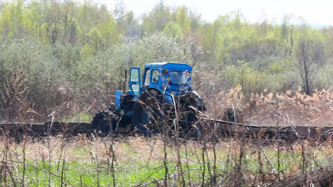 tractor plowing at spring Stock Video Footage