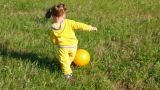 Little Girl Playing With Ball On Meadow stock footage