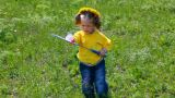 little girl playing badminton on spring meadow Footage