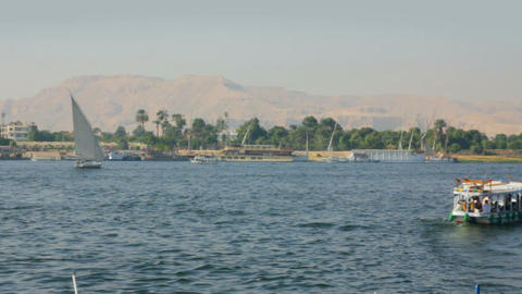 boats on Nile River in Luxor, Egypt - timelapse Stock Video Footage