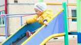 cute little girl in yellow on slide - slow motion Footage