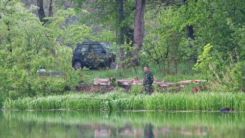 fishing men on lake at rain Stock Video Footage