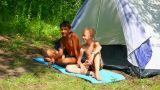 camping children near tent in forest Footage