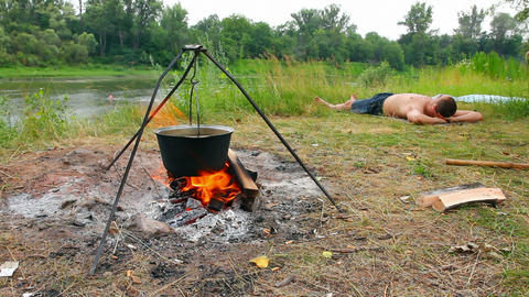 camping - kettle over campfire Stock Video Footage