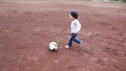 Boy kicking a ball Footage