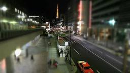 東京タワーと夜の街の人と車の流れ Footage