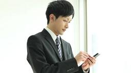 A businessman using a Smartphone Footage