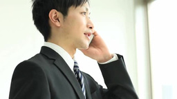 Businessman Speaking By Mobile Phone stock footage