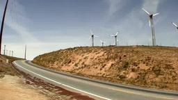 通過する大型トラックと丘の上の風力発電 Footage