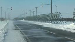 地吹雪の道と車 Footage