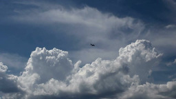 Clouds And An Airplane stock footage