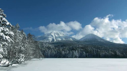 雪に覆われたオンネトーと阿寒富士と雌阿寒岳... Stock Video Footage