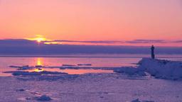 灯台と流氷とけあらしの日の出 Footage