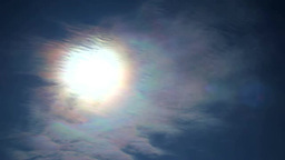 Iridescent clouds and the Sun Footage
