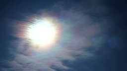 Iridescent clouds and the Sun Stock Video Footage