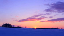 Sunrise at a snowy field Stock Video Footage