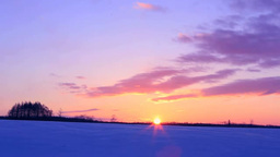 Sunrise at a snowy field Footage