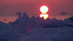 流氷の海の日の出と漁船 Footage