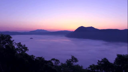 Foggy Lake Mashu at dawn Stock Video Footage