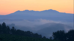 Hill and Mt. Taisetsuzan in the morning mist Stock Video Footage