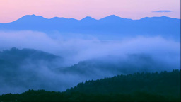 Hills and the Tokachi mountain range in morning mist Footage