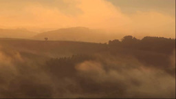 Hill in morning fog Stock Video Footage