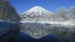 hoarfrost of Shiribetsu river and Mt Yotei Stock Video Footage