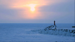 Drift ice and lighthouse in the morning Stock Video Footage