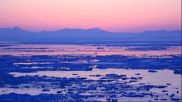 Drift ice and Shiretoko mountain range seen from... Stock Video Footage