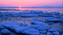 流氷と国後島からの日の出 Stock Video Footage