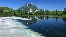 残雪の三の沼と羅臼岳 Stock Video Footage