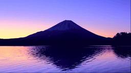 日の出の富士山と精進湖 Stock Video Footage